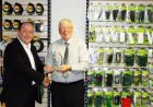 1.	Tony Robson (left) receives the 'Agent of the Year' award from operations director, Tony Dedm