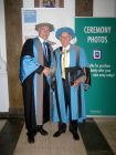 Colin Squire (right) receiving his honorary degree from Ron Tuninga (left).