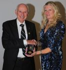 Colin Squires receiving the Pearson Memorial Medal from Carol Paris.