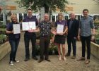 Fairways Garden Centre, Ashbourne with their awards & (centre) Michael Cole, (2nd right) Mike Lind &