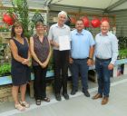 Left, Alyson Haywood and right Mike Lind, with staff from Squires Garden Centre, Hersham.