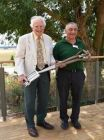 : The Sun's Peter Seabrook (L) presents Colin Randel (R) with engraved garden fork and spade.